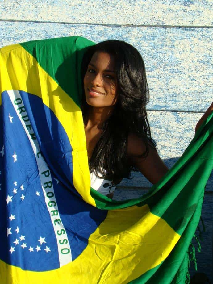 Brazilian model holding her national flag