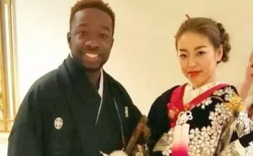 Black man and Japanese woman in traditional clothing